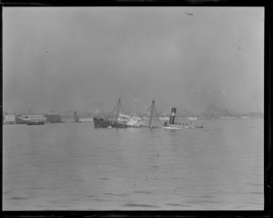 Distant view of the steamer Peirce sunk in Harbor after collision