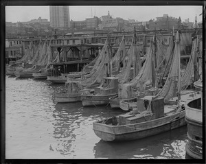 Drying nets at old T-wharf. Charles M. Falici II et al. boats.
