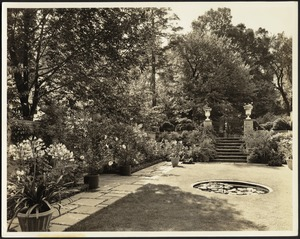 Ashdale Farm. Rose garden, reflecting pool and potted plants; stair entrance with urns on right