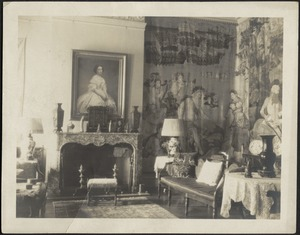 Interior — Sitting room looking towards fireplace, tapestries on right