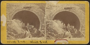 West entrance of arch, with miners on cart
