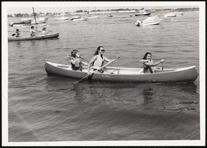 3 people in a canoe