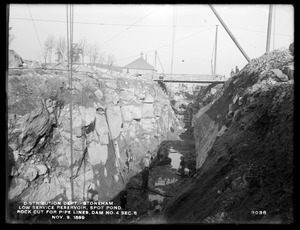 Distribution Department, Low Service Spot Pond Reservoir, rock cut for gate chamber foundation, inlet conduit and 60-inch pipe lines, Dam No. 4, Section 6, from the south, Stoneham, Mass., Nov. 9, 1899