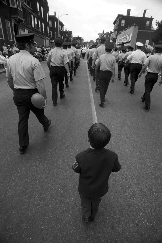 Boy follows 4th of July parade marchers, Charlestown