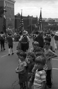 Boys watch 4th of July parade, Lawrence