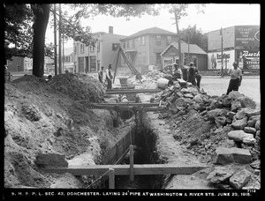 Distribution Department, Southern High Service Pipe Lines, Section 43, laying 24-inch pipe at Washington and River Streets, Dorchester, Mass., Jun. 23, 1915