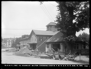 Distribution Department, Southern High Service Pipe Lines, Section 43, crossing over New York, New Haven & Hartford Railroad at Adams Street, Milton, Mass., Aug. 16, 1915