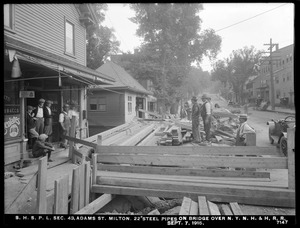Distribution Department, Southern High Service Pipe Lines, Section 43, 22-inch steel pipes on bridge at Adams Street over New York, New Haven & Hartford Railroad, Milton, Mass., Sep. 7, 1915