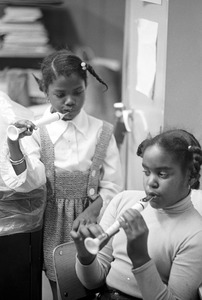Black schoolchildren play recorders, Roxbury