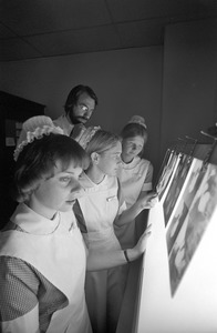 Mass. General Hospital student nurses, doc & instructor check x-rays, Boston