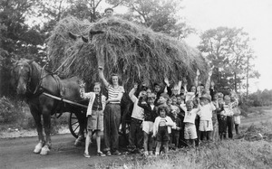 Alfred Fuller giving a hayride to the campers at Fair Acres