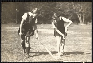 Ellen K. Pernaa, on left - and Elaine Cleaves, student head of hockey at Fitchburg S.T.C., are demonstrating the technique of stick handling in field hockey.