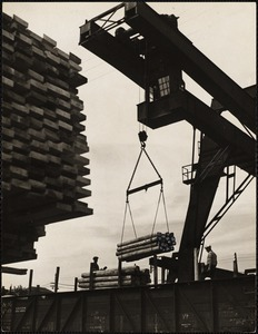 Loading railroad - ties onto flat cars at Wiggins terminals in Charlestown