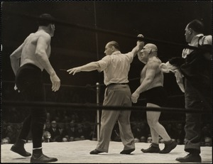 Referee Sonnenberg awards the championship to The Angel. Casey was disqualified for attacking Gus Sonnenberg
