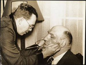 Earnest A. Hooton getting bizygomatic (face breath) palpating (feeling) for the arches