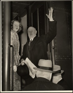 James A. Farley leaving Boston's Back Bay R.R. Station with daughter Peggy for New York