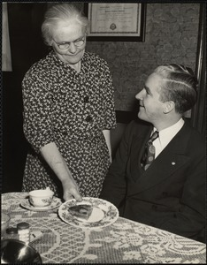 John E. Kerrigan's mother serving him a piece of homemade pie
