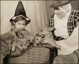 Miss Betty Place and Mrs. W.L. McCammon with Welsh corgis