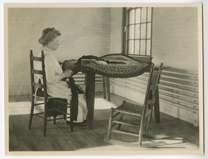 Woman Who is Deafblind Braiding a Rug, Woolson House