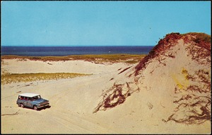 Beach buggies touring the sand dunes along Race Point, Provincetown, Cape Cod, Mass.