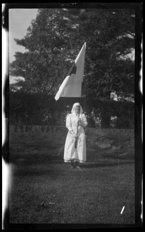 Marcher with Red Cross flag in the Welcome Home parade