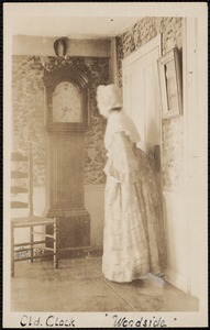 Woodside, 18 Brewster Road, interior view, clock and unidentifed costumed person