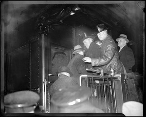 Gov. Curley shown with Mayor Fred W. Mansfield and Commissioner Eugene M. McSweeney on Roosevelt's special train