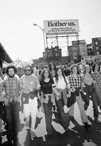 """Anti-war demonstrators march to rally (note """"Bother Us"""" sign), Charlestown"""