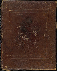 Portrait of woman holding book in lap
