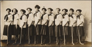 Junior Hockey Team, 1910, standing with hockey sticks