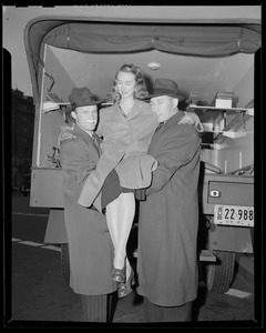 Clapper, Crowley, and model in front of ambulance