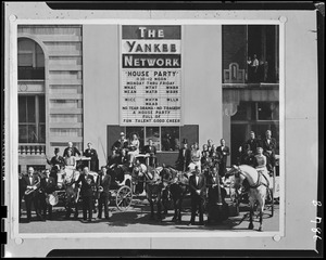 Yankee House Party performers with billboard