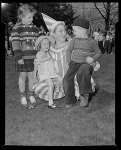 Woman in mime clown costume with children