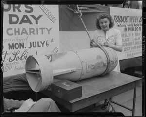Jean Collins signs a bomb at the WEEI Day on the Common