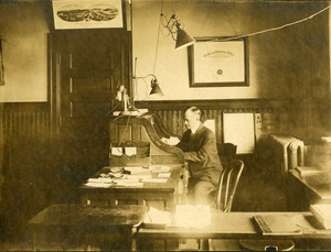 Charles Eugene Monroe in his second optometry office in Southbridge Massachusetts
