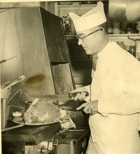Dr. Ralph C. Monroe cooking during businessmen's day in Southbridge Massachusetts