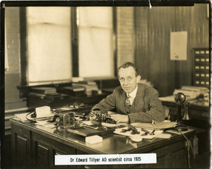 Portrait of Dr. Edgar D. Tillyer, at his desk, at the American Optical Company Southbridge
