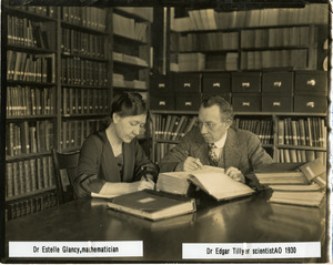 Dr. A. Estelle Glancy and Dr. Edgar D. Tillyer at work on a calculation, at the American Optical Southbridge