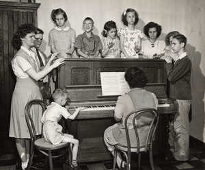 Students Surrounding Piano