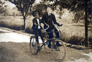 Thomas and Joseph on a Sociable Tricycle