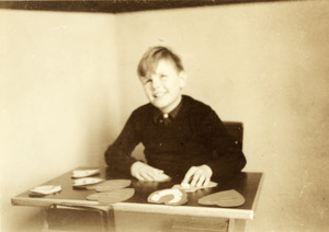 Leonard Dowdy seated with Paper Hearts