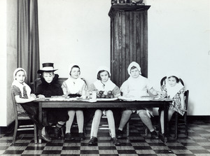 Seated at a table in costume - Perkins School for the Blind