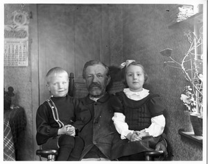 Old man with small boy and girl