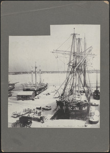 Whaling ships docked at wharf in New Bedford in winter