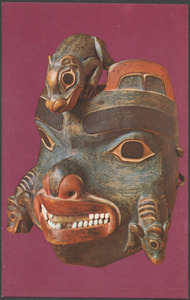Carved wooden mask with animals