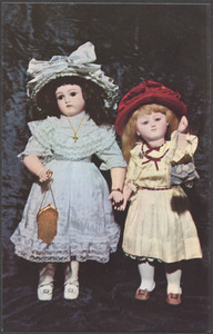 Left, fine, French Belton doll - jointed body - ice pale blue silk and lace outfit. Right, closed-mouth French Steiner doll - dressed in cream, with garnet velvet ribbon trip and felt hat
