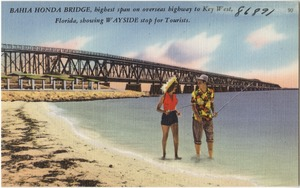 Bahia Honda Bridge, highest span on Overseas Highway to Key West, Florida, showing wayside stop for tourists.