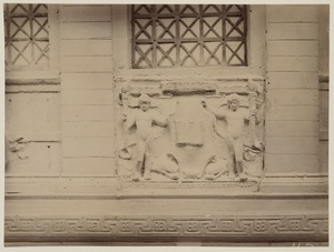 Depiction of Boston Public Library seal on plaster model of the McKim Building