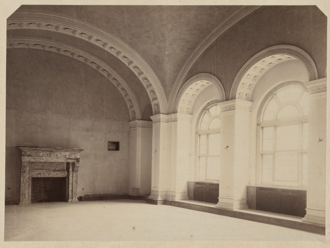music library showing fireplace and two of 3 arched windows