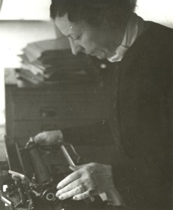 Polly Thomson Leaning over a Typewriter